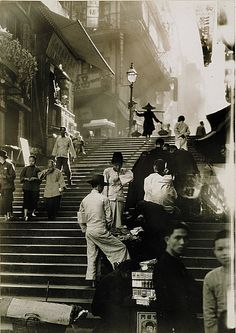 by W. Robert Moore Hong Kong Vendors and pedestrians along a steep staircase.