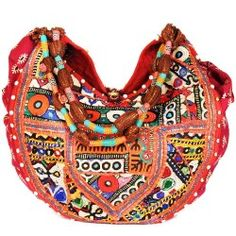This unique and typical Rajasthani Jhola bag is unbelievably stylish. Any lady that flaunts it, is sure to entice eye-balls and receive praises. Colorful prints along with fine threading and mirror based works brings out a dazzling effect.