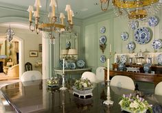 Two chandeliers and an amazing collection of blue and white porcelain in a dining room - Cathy Kincaid Interiors