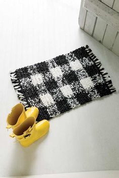 crochet a rug with trash bags or use the pattern with thick yarn for a softer rug.