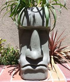 Scaled down replicas of the ancient and mysterious bald stone head monoliths found along the Easter Island coastline that double as fun planters you can line up along your patio or garden. Face Planters, Garden Planters, Cement Planters, Garden Statues, Garden Sculpture, Easter Island Moai, Tiki Head, Backyard Creations, Concrete Crafts