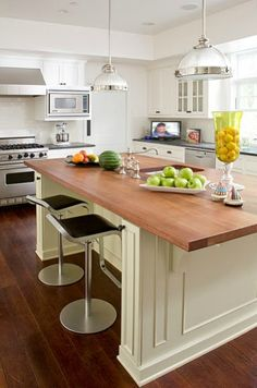 Suzie: Nadia Designs - Two-tone kitchen design with white kitchen cabinets with black granite ...