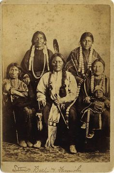 Standing L-R: Good Feather Woman (Sitting Bull's sister), Walks Looking (Sitting Bull's daughter) Sitting L-R: Her Holy Door (Sitting Bull's mother), Sitting Bull, Many Horses (Sitting Bull's daughter) with her son, Courting A Woman - Hunkpapa - 1883