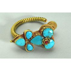Earring Place of Origin: Tibet Date: 1925-1975 Object Name: Jewelry Materials: Gold and turquoise