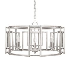 Square motif drum chandelier with 6 arm light in silver leaf.