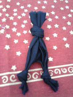 8-Dê um nó em cada perninha. Se o nó ficar no meio da perna vá puxando até a ponta.