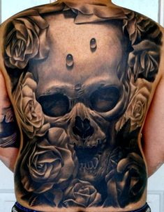 Skull tattoo design - not my style, but way more compelling than the average skull tatt!