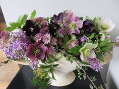 Vintage Constance Spry Vase filled with Spring lilacs and purple hellebores