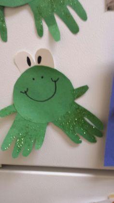 handprint frog craft hanging on the fridge