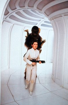 Princess Leia, Chewbacca and rush to save Han Solo from Boba Fett in Star Wars The Empire Strikes Back Star Trek, Star Wars Love, Star Wars Film, Star Wars Art, Han And Leia, Leila, Pin Up, The Empire Strikes Back, Carrie Fisher