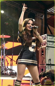 Becky G Performs In The Rain At DirecTV's Super Fan Festival