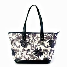 TODIE'S TAPERED TOTE - MORNING HAS BROKEN A tote to use every day with one zippered interior pocket and two open accessory pockets. One exte...