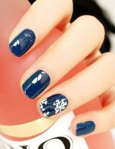 Midnight blue and white snowflake nail art design. Simple yet elegant winter nail art design that will surely match with the winter season.: