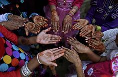 Easter 2013 Around The World  Pakistani Christian girls, display their hands decorated with Bangles and painted with Henna paste as they celebrate Easter holiday following a mass at in a Christian neighborhood in Islamabad, Pakistan, Sunday, March 31, 2013.