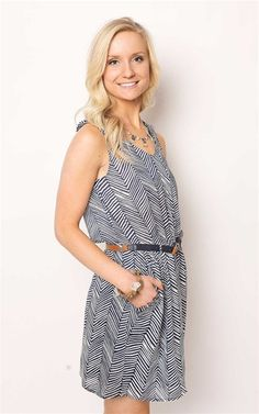 The Navy & White Nautical Dress With Belt at Dress and Dwell - Good things for you and your home. Price: $72. This nautical dress has a breezy cut and boasts a girls best friends, pockets! Channel Katie Holmes classic vibe and pair this dress with strappy sandals or classic white tennies!