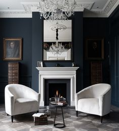 Navy walls and white trim.. Beautiful pre-war apartment with wonderful trim details look at the ceiling lovely chairs however much more comfortable if they had more arm space and an ottoman. . just my opinion