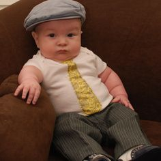 Oh my goodness!!   What a lil man!  Tie onesies will be making an appearance if it turns out to be blue