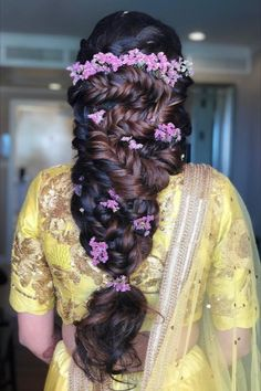 Check these stunning hair look styled with exotic purple flowers perfect for your intimate wedding.   #Indianweddings #shaadisaga #indianbridalhairstyles #hairstyleswithflowers #intimatewedding #realflowers #uniquecolourlehenga #babybreaths #lowbun #exoticflowerhairstyle #carnations #mermaidbraid #purpleflowerhairstyle Exotic Flowers, Real Flowers, Purple Flowers, Mermaid Braid, Indian Bridal Hairstyles, Types Of Flowers, Carnations, Hair Looks, Lehenga