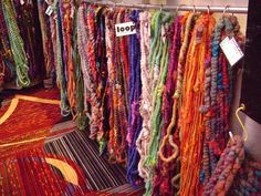 Loop art yarns- what a great way to display them! You can see so much of them, and they're easily touched.