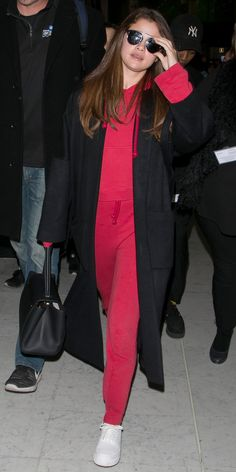 Selena Gomez makes an all red jumpsuit look super chic.