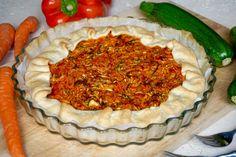 TORTA SALATA ZUCCHINE, CAROTE E PEPERONI La Torta Salata Zucchine, Carote e Peperoni è un piatto Facile, Veloce e soprattutto Versatile. La possiamo servir