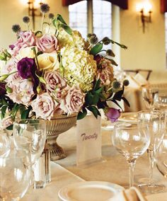 Millburn florist Flowers & Events From the Ground Up created centerpieces of hydrangeas, lisianthus, Sterling & Vendela roses, eryngium, & ruscus in silver urns.