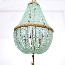 aucourant-interiors.com sea glass beaded chandelier