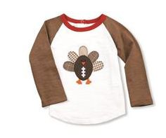 Get your turkey and football on! This stylish cotton slub raglan style tee with contrasting sleeves and neck binding and back snap placket features felt football turkey applique with woven...