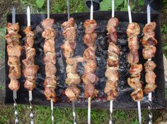Shashlik cooks on a hot grill. Kakheti, the easternmost province in the Republic of Georgia, is known for meats grilled over grapevines, whi...