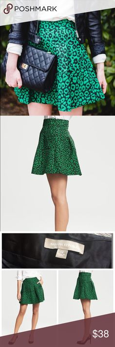 Banana Republic Emerald Green Leopard Skirt sz 12 This gorgeous, emerald green & black jacquard leopard, animal print BANANA REPUBLIC skirt features A-line cut with Banded waist.  Can be dressed up or down with ease. Perfect addition to any Winter wardrobe. (Model is 5'11) Textured jacquard skirt in a fit-and-flare silhouette. Banded waist. Invisible back zip. On-seam, front welt pockets. Material:  59% Cotton, 39% Polyester, 2% Spandex. Measurements: Waist: 16 inches   Length: 18 inches…