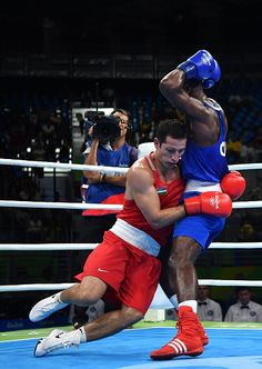 #TOPSHOT Uzbekistan's Elshod Rasulov is knocked out by Great Britain's Joshua Buatsi during the Men's Light Heavy match at the Rio 2016 Olympic Games...