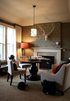 Chimney sweep. This modern take on a traditional room has wallpaper only on the chimney breast. It immediately draws the eye to the contempo...