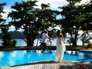 iStock - BUY ME! - Newly-Weds Jump Into Pool Overlooking the Ocean stock photo 64220043 - iStock