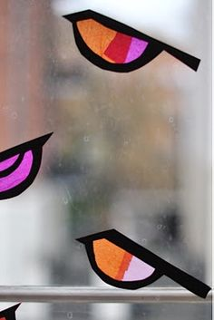 Cute stained glass birds using tissue paper.