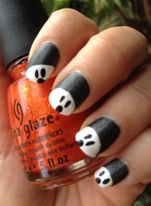 Peek a Boo Ghosts.  Halloween Manicure. *thought these were pandas lol*
