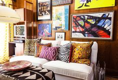 If Kim is entertaining, she and friends often end up in the den, made extra cozy by vibrant art prints and patterns | Browns, white, pops of color.