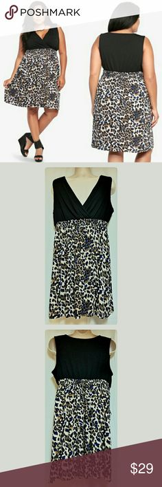 "Torrid Cheetah Print Tank Dress Torrid Size 2 Item-0078.  This is a Torrid cheetah print with blue tank dress. It  is a Torrid Size 2 which is the same as a size  18/20 or size 2X. Measurements taken while garment was laying flat and then doubled.  Bust 39"" around.  Waist is elasticized and stretches from 34"" to 42"" around.  Hips 51"" around.  Length from edge of shoulder to hem 37.5"".  This dress is in excellent condition. Torrid Dresses Mini"