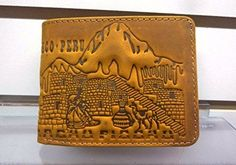 Leather Wallet, Unisex Wallet with traditional Peruvian Design, Peruvian Cultural Wallet with Machu Pichu and Tumi, Detailed Artisan Wallet. A nice leather wallet with different traditional peruvian motifs. This is a nice and good quality wallet made in genuine leather with motif of Machu Pichu, Inti Raimi on a Tumi, a peruvian chuyo hat and a highkand couple on the front and a big Machu Pichu motif on the back.. The wallet is also embossed with a tiny motif of Machu Pichu on the inside…
