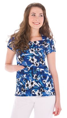 911aef7ce6b Style Code: A fun appeal with just a hint of flirty comes with this Urbane  scrub top featuring the trendy Floral Pop in Galaxy print.
