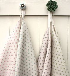 Sarah Hardaker - Spotty Fabric Collection - A round coat hook and a flower shaped coat hook, each with two fabrics hanging from it in cream, with different pastel coloured polka dots Roman Blinds, Coat Hooks, Flower Shape, Vintage Patterns, Vintage Inspired, Textiles, Colours, Fabrics, Polka Dots
