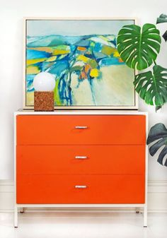 DIY Floating Frame for Abstract Artwork on Herman Miller Chest with Cork Lamp and Plant