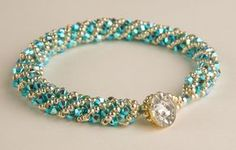 Turquoise blue Swarovski Crystal delicately woven with silver glass beads and a vintage button for a closure. This item can be done in any color of your choice to match any outfit or for the Bride and