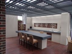 kitchen in outdoor area, slats on roof and laserlight over the top of slats