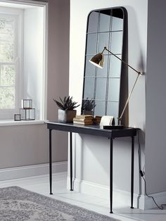 Made from metal with a distressed, vintage-effect finish, our mottled black console table is perfect for displaying ornaments and keepsakes in your hallway or living space. To complement the look, also see our matching Antiqued Metal Side Table affiliate Hallway Console, Hallway Furniture, Entryway Decor, Home Furniture, Hallway Tables, Iron Console Table, Marble Desk, Industrial Windows, Houses