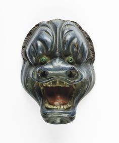 Okimono of carved wood lacquered in colours, a miniature reproduction of a No drama mask: Japan, 19th century