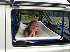 Genius idea.  Homemade hammock hangs above the front seats.  Sturdy enough for children to sleep on or store gear.