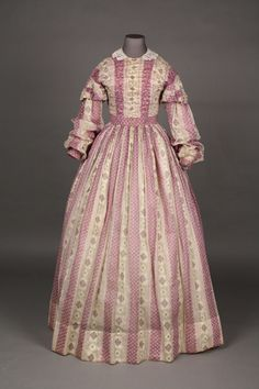 Dress: ca. 1855-1865, striped cotton, boned bodice, piped seams, skirt lined in linen.