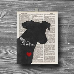 Book page quote- HOME IS WHERE THE DOG IS  Image of dog has a mottled dark grey/black effect. printed on a vintage dictionary page using premium
