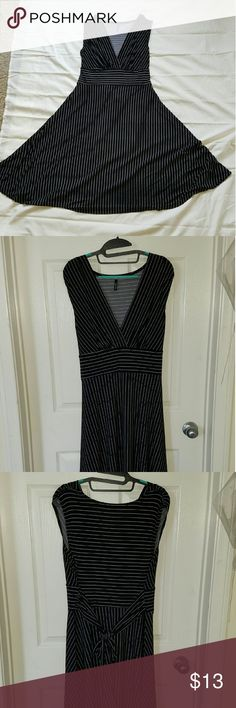 Black Swing Dress with White Strips This dress is super comfortable and moves beautifully when you walk. Have criss-cross front and cap sleeves. Maurices Dresses Midi