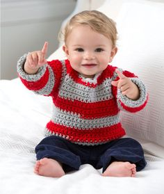 Go Team Go! Baby Sweater..easy to make with Red Heart yarn that will make its own stripes because of two color skeins ...free pattern!